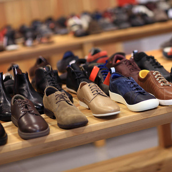 Shoes on the wooden shelf in the store